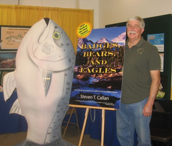 The CDFW booth is a good place to hob-nob with local celebrities.  Author Steve Callan and the Coleman National Fish Hatchery mascot pose with a poster of Steve's book,